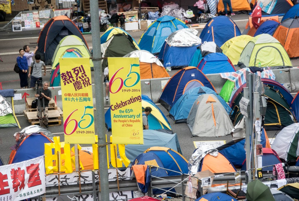A tent city has sprung up beneath banners celebrating the 65th anniversary of the People's Republic of China.