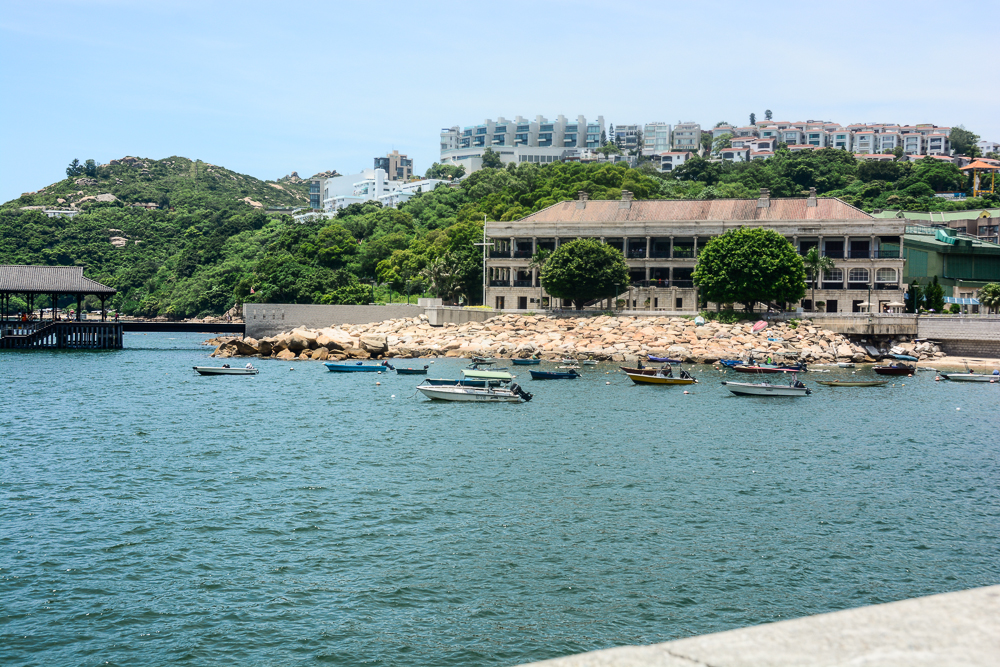 Murray House, a colonial army barracks built in 1844, was dismantled stone by stone and relocated to the Stanley waterfront from its original site in Central where the Bank of China Building now stands.